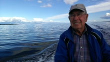 Frank Jelich at the helm, mountains in the background, another beautiful day for fishing